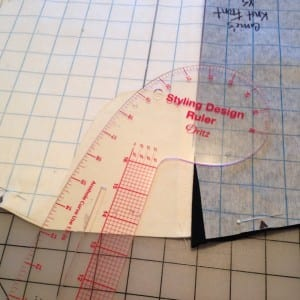 Shaping neckline with Styling Design ruler.