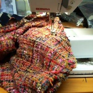 Stitching the sleeve seam.