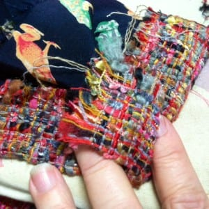 Mitering the boucle at the hem.