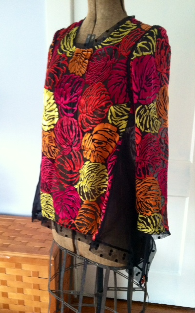 A Tunic with beaded swing side.