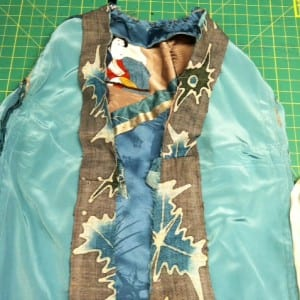 Placing the base band to the jacket on the inside.