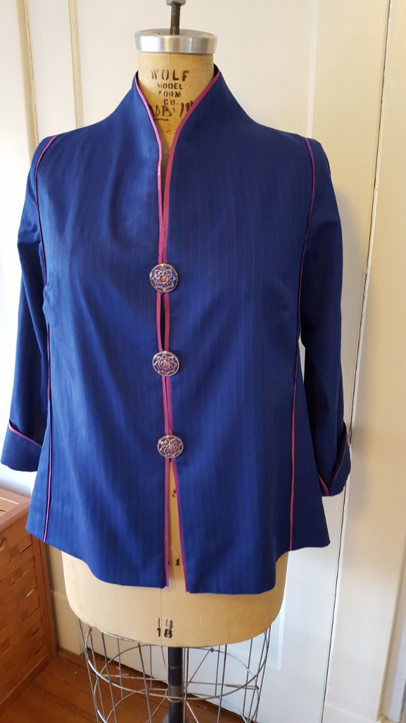 Blue silk shirt with pink trim.