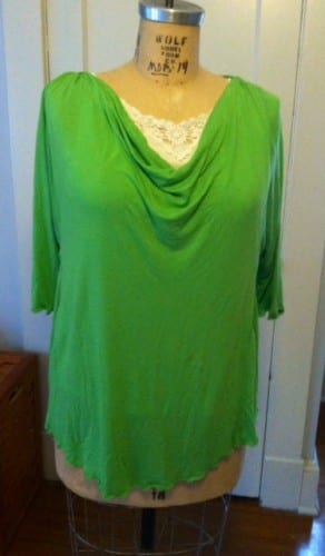 Green draped tee with curved hemline.
