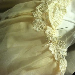 Adding lace from her mothers dress onto Erin's petticoat.