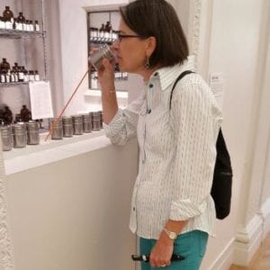 Carrie sniffing at the smell exhibit.