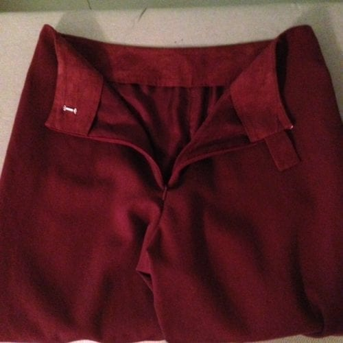 Inside view of finished pants with lining, faced waist and tab.