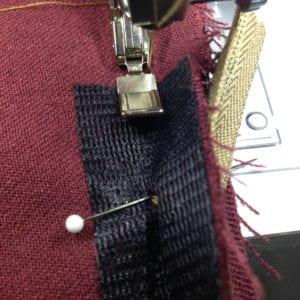 Sewing crotch seam below zipper.