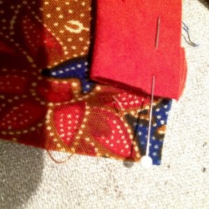 Baste piping to center front, ending at hemline