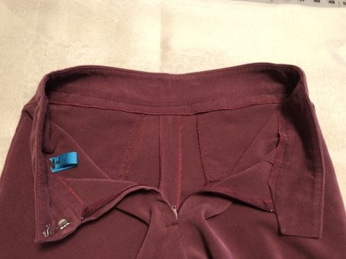 Interior view of fingertip pockets and contour waistband.