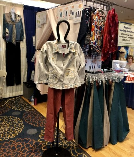 The Eureka! Pants fitting booth, with our girlfriend modeling the Paris Postcard Jean Jacket.
