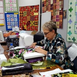 Sewing on the jacket during the Capital Quilts class last year.